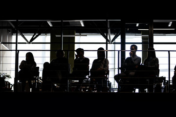 Audience on balcony at a business conference. Silhouette photo.