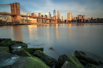 View on brooklyn bridge and manhattan from the rocks during sunrise