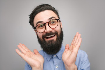 Handsome bearded hipster looking happy