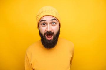 Shocked emotional bearded man