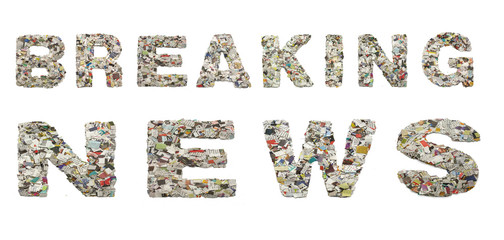 the words BREAKING NEWS with newspaper confetti