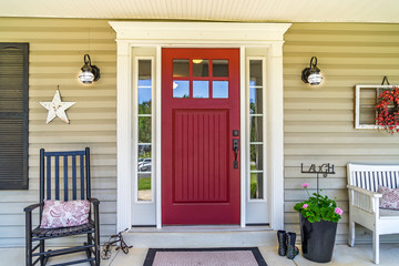 Red Door Farmhouse Front Porch with Rocking Chair