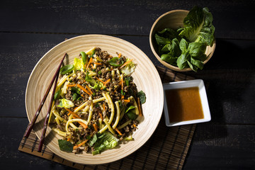 Asian mincemeat salad with macaroni, ginger, chili, garlic, carrot, spring onion, soy lemon sauce