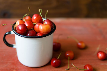 Soft view on sweet red cherries on wooden background, close-up and isolated view