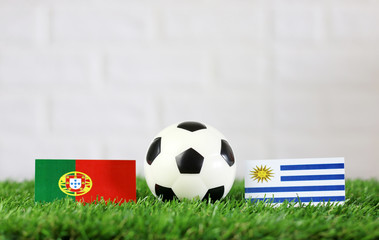 ball with Uruguay VS Portugal flag match on Green grass football 2018