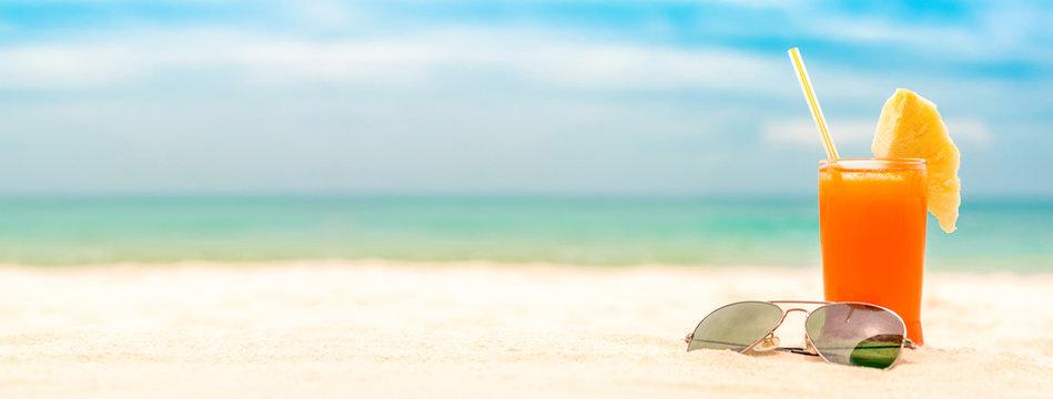 Refreshing fruit punch drink in summer white sand beach banner background