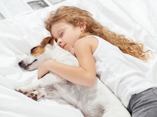 Child sleeping with dog