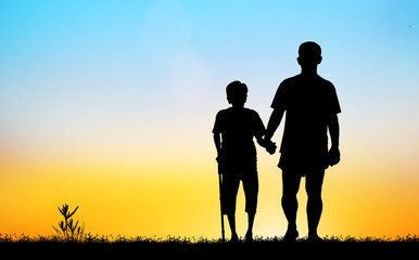 silhouette of the old man and son walk in the park    on blurry sunrise background.