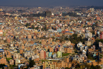 View of Katmandu from the Swayambhunath , an ancient religious architecture atop a hill