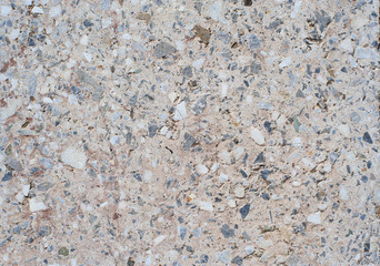 The texture background of a light granite tile interspersed with stone for design. Granite slab, marble texture