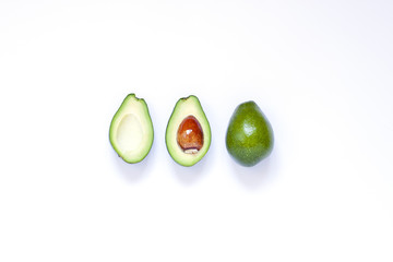 Avocado on the white background. Top view