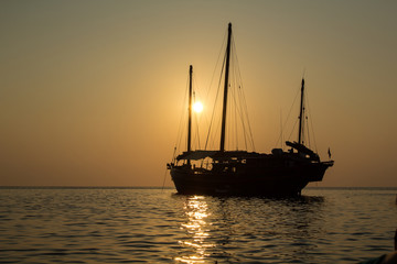 Old junk in the sunset in the Andaman sea in Thailand