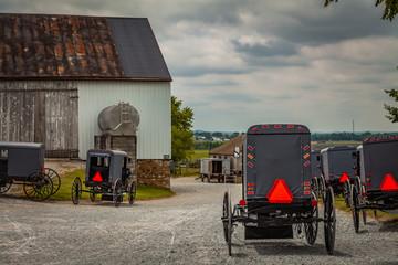 Assorted Amish Buggies at Barn