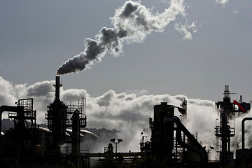 Vapor is released into the sky at a refinery in Wilmington