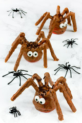 Halloween spider cakes with candy eyes in chocolate, Halloween treats for kids