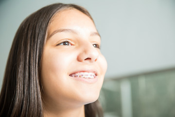 Smiling Teenage Girl With Braces In Dental Clinic