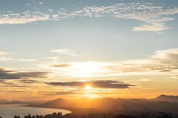 Sunset sky with city on coast