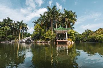 Oriental building on lake coast