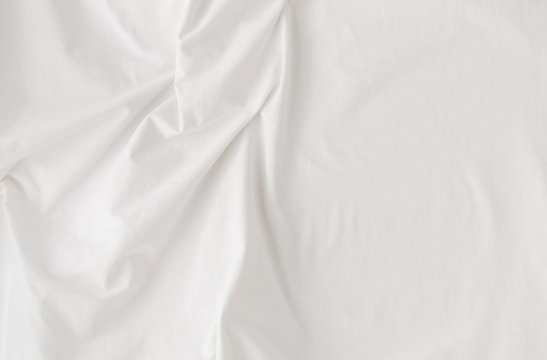 white bed sheet with folds, close-up, top view, soft day light