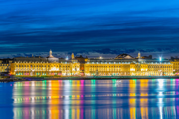 Night view of Place de la Bourse viewed over river Garonne from Stalingrad part of Bordeaux, France