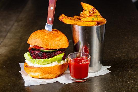 Burger with potato and ketchup
