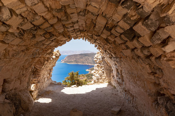 Sea view from the ruins of a small chapel. The castle of Monolithos on Rhodes island. Greece
