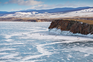 Travelers go skiing on the ice of lake Baikal the view from the top.