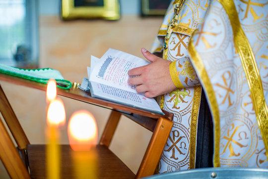 Baptism of Child. Holy Father reads prayer, near baptismal font