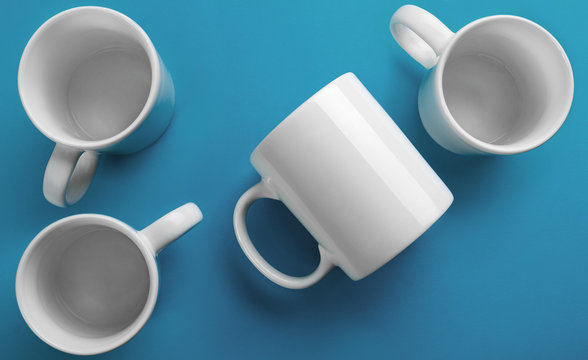 White mug side and top view on blue background