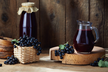 Freshly picked home grown blackcurrants and homemade blackcurrant juice