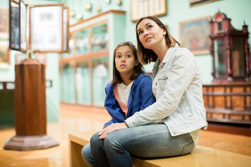 Mother and daughter exploring expositions