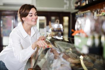 Woman choosing dessert