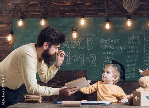 Wunderkind And Genius Concept Father Teacher Reading Book Teaching Kid Son