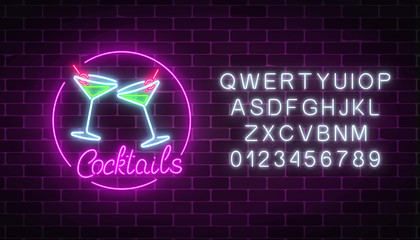 Neon cocktails bar sign with alphabet. Glowing gas advertising with glasses of alcohol shake.