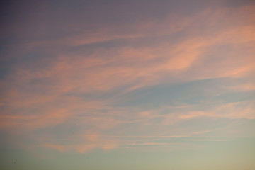 Pink sunset sky with clouds