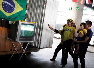 Brazilian fans celebrate Thiago Silva's goal under the Alcantara Machado viaduct in the Mooca neighborhood of Sao Paulo
