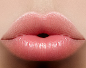 Closeup kiss natural lip makeup. Beautiful plump full lips on female face. Clean skin, fresh make-up. Spa tender lips