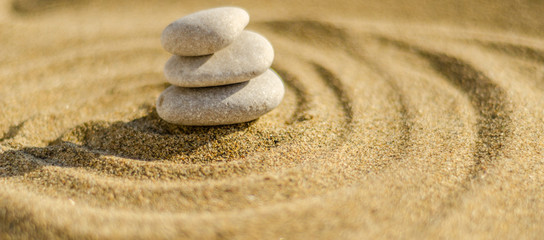 zen meditation stone in sand, concept for purity harmony and spirituality, spa wellness and yoga background