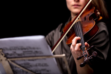 violinist playing in front of her score