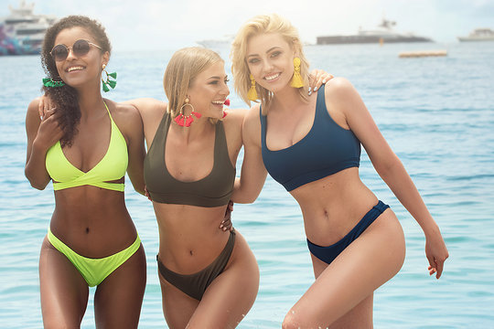 Three beautiful girls having fun on the beach.