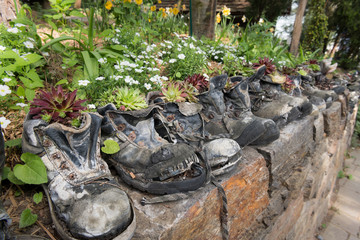 Old hiking boots used as flower pots