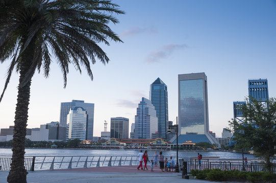 Jacksonville, FL/ USA 07/25/2017- The Jacksonville skyline can be seen across the water as evening sets in.