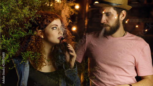guy and girl smoking