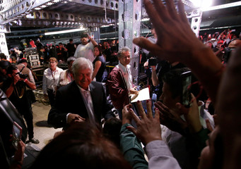 Mexican presidential candidate Andres Manuel Lopez Obrador greets supporters after his closing campaign really at the Azteca stadium, in Mexico City