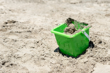 Sandy bucket on the beach