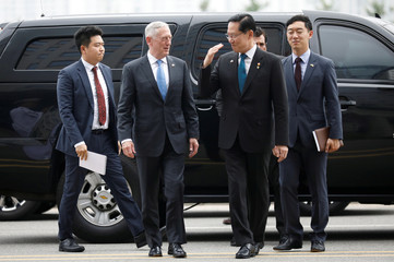 U.S. Defence Secretary Jim Mattis is greeted by his South Korean counterpart Song Young-moo upon his arrival at the Defence Ministry in Seoul