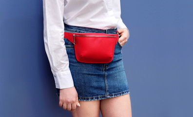 Wall Mural - Trendy red stylish belt leather bag on woman