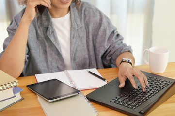 Portrait of female executive sitting at her desk in office