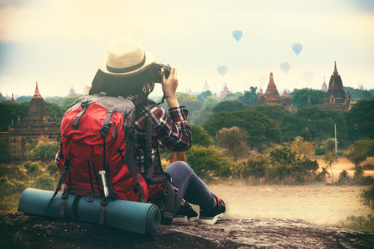 Backpacking woman traveller and photographing in Bagan Mandalay Myanmar