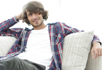 serious modern guy sitting on the couch